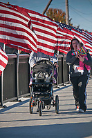 Walkers cross the Main Street Bridge toward the finish line at the Westerville Rotary Club's Honor Flight Run in Alum Creek Park. The fund raiser early in the morning helped raise money and awareness for the groups honor Flight program to fly WWII veterans to the world War II Memorial in Washington at no cost.