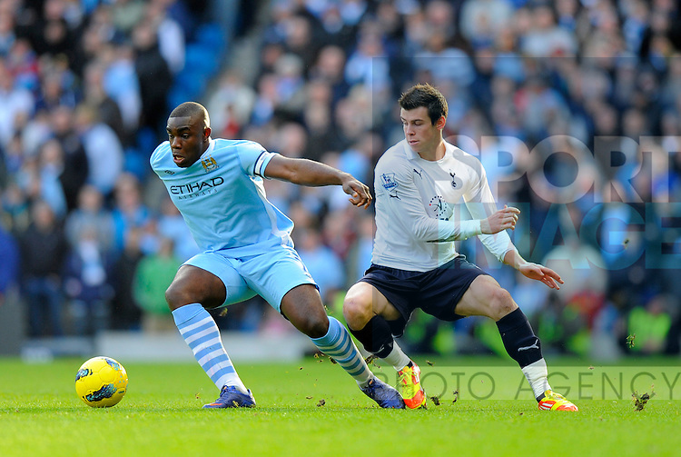Micah Richards of Manchester City holds off Gareth Bale  of Tottenham.Barclays Premier League.Manchester City v Tottenham at the Eithad Stadium, Manchester 22nd January, 2012..Sportimage +44 7980659747.picturedesk@sportimage.co.uk.http://www.sportimage.co.uk/.Editorial use only. Maximum 45 images during a match. No video emulation or promotion as 'live'. No use in games, competitions, merchandise, betting or single club/player services. No use with unofficial audio, video, data, fixtures or club/league logos.