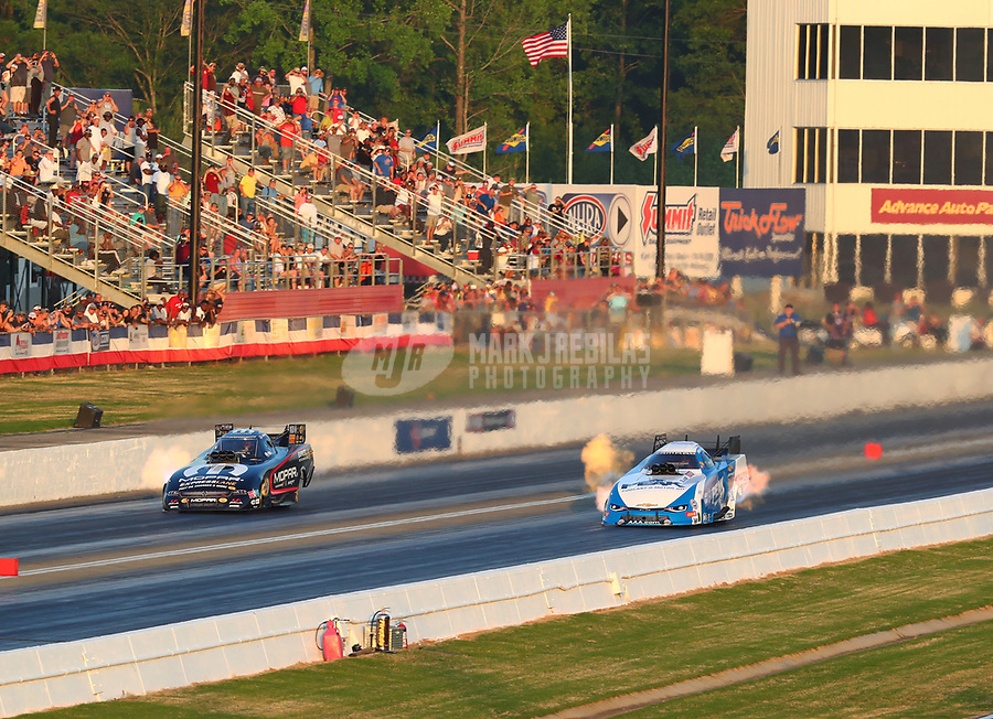 May 4, 2018; Commerce, GA, USA; NHRA funny car driver Matt Hagan (left) races alongside John Force during qualifying for the Southern Nationals at Atlanta Dragway. Mandatory Credit: Mark J. Rebilas-USA TODAY Sports