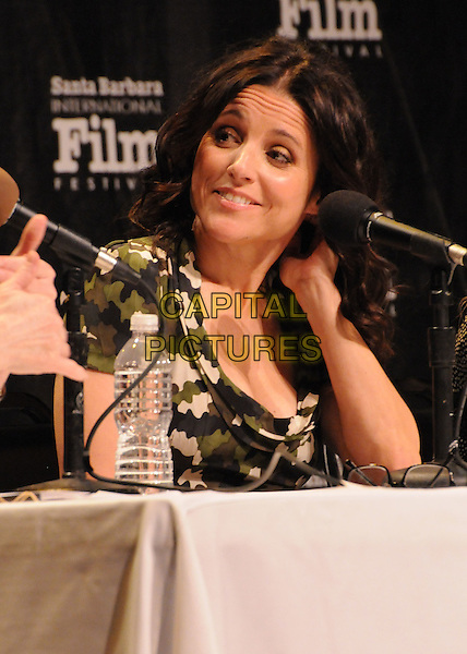 "Julia Louis-Dreyfus.27th Annual Santa Barbara Film Festival: ""Creative Forces: Women in The Biz"" Panel held at the Lobero Theatre, Santa Barbara, California, USA, .28th January 2012..half length microphone sitting conference .CAP/ADM/BP.©Byron Purvis/AdMedia/Capital Pictures."