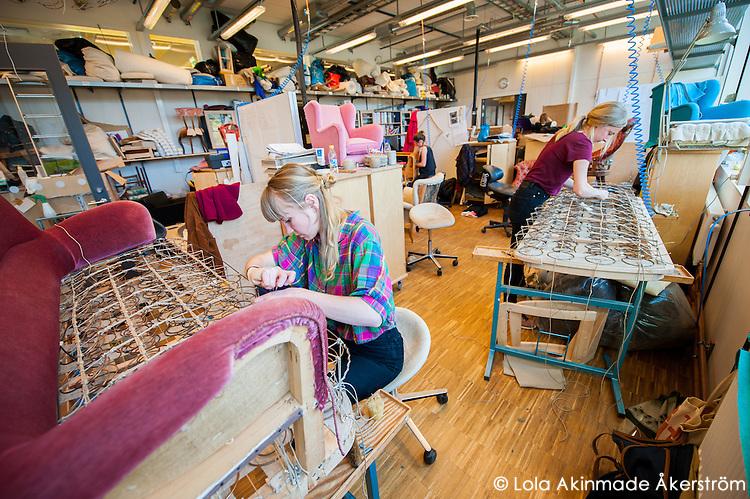 Furniture upholstery students refurbishing old sofas.