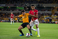 Pedro Neto of Wolves & Mason Greenwood of Man Utd during the Premier League match between Wolverhampton Wanderers and Manchester United at Molineux, Wolverhampton, England on 19 August 2019. Photo by Andy Rowland.