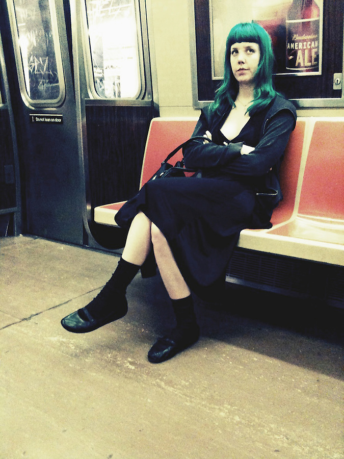 People riding the subway in New York City.