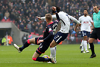 Florent Hadergjonaj of Huddersfield Town and Son Heung-Min of Tottenham Hotspur during Tottenham Hotspur vs Huddersfield Town, Premier League Football at Wembley Stadium on 3rd March 2018