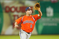 Third baseman Wes Gilmer #11 of the Auburn Tigers fields a ground ball against the Alabama Crimson Tide at Riverwalk Park on March 15, 2011 in Montgomery, Alabama.  Photo by Brian Westerholt / Four Seam Images