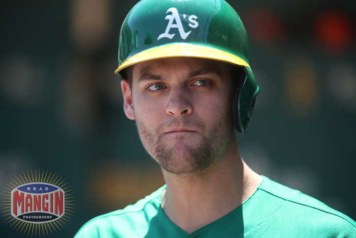 OAKLAND, CA - JULY 17:  Chad Pinder #18 of the Oakland Athletics stands in the dugout during the game against the Seattle Mariners at the Oakland Coliseum on Wednesday, July 17, 2019 in Oakland, California. (Photo by Brad Mangin)