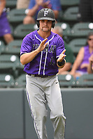 Center fielder Sky Overton (17) of the Furman Paladins claps after scoring a run in a game against the UNC Greensboro Spartans at the Southern Conference Baseball Championship on Saturday, May 27, 2017, at Fluor Field at the West End in Greenville, South Carolina. UNCG won, 12-8. (Tom Priddy/Four Seam Images)