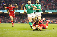 Pictured: Scott WIlliams of Wales scores a try, team mate Dan Biggar (L) celebrates Saturday 14 March 2015<br />