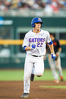 Florida Gators designated hitter JJ Schwarz (22) runs to third base against the Miami Hurricanes in the NCAA College World Series on June 13, 2015 at TD Ameritrade Park in Omaha, Nebraska. Florida defeated Miami 15-3. (Andrew Woolley/Four Seam Images)