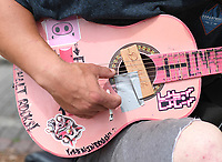 Max Arellano plays his guitar Thursday May 14, 2020 on the sidewalk along Dickson St. in Fayetteville. Visit nwaonline.com/200515Daily/ for daily image galleries. (NWA Democrat-Gazette/J.T. Wampler)