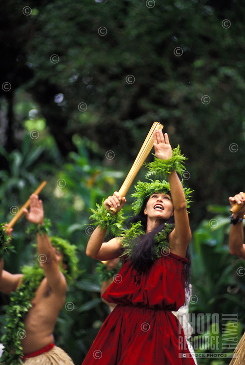 Dancing hula with puili (slit bamboo) at Prince Lot festival, Island of Oahu