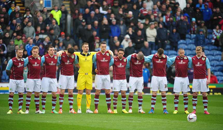 Burnley players observe a minutes silence to remember the victims of the Hillsborough disaster<br /> <br /> Photo by Chris Vaughan/CameraSport<br /> <br /> Football - The Football League Sky Bet Championship - Burnley v Middlesbrough - Saturday 12th April 2014 - Turf Moor - Burnley<br /> <br /> &copy; CameraSport - 43 Linden Ave. Countesthorpe. Leicester. England. LE8 5PG - Tel: +44 (0) 116 277 4147 - admin@camerasport.com - www.camerasport.com