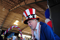 "Tempe, Arizona. October 13, 2012 - A man dressed as ""Uncle Sam"" who was standing on stilts was one of the attractions of a colorful non-partisan political rally where hundreds of registered voters learned more about candidates the campaign process. Hundreds of Arizona registered voters participated in a political rally where candidates for the US Senate, House of Representatives, state legislature, Maricopa County and other public offices pitched for votes for the upcoming general election. Photo by Eduardo Barraza © 2012"