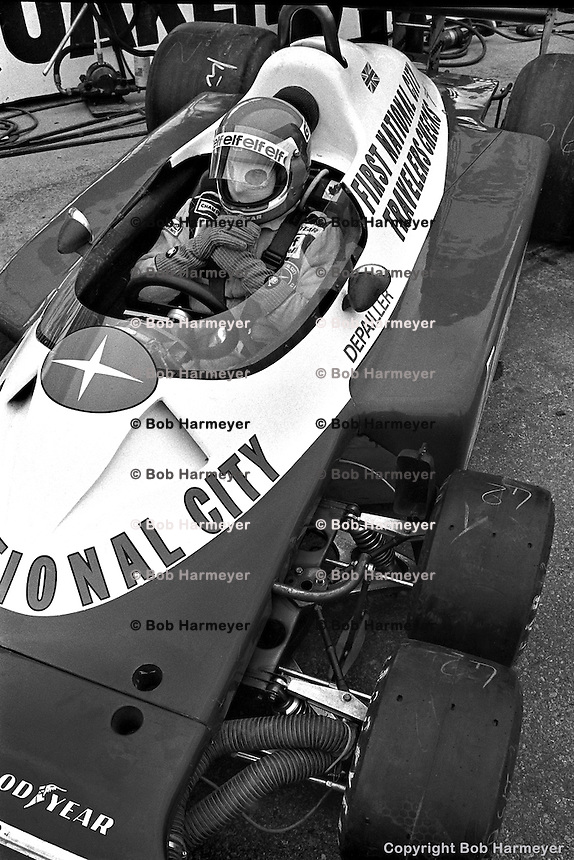 BOWMANVILLE, ONT: Patrick Depailler waits to drive the Tyrrell P34 7/Ford Cosworth DFV before practice for the Canadian Grand Prix on October 9, 1977, at Mosport Park near Bowmanville, Ontario.
