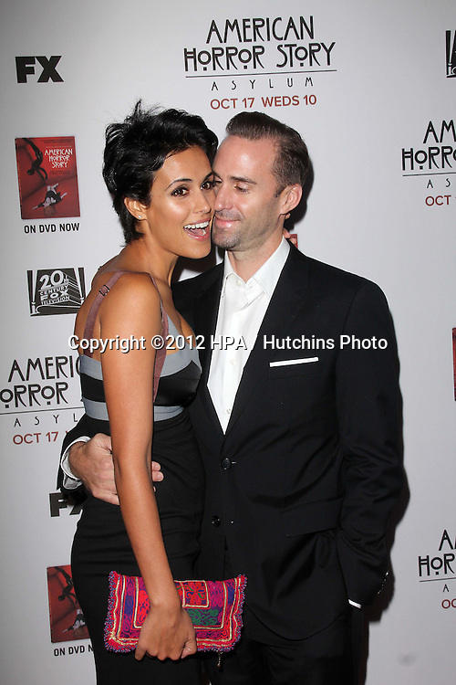 "LOS ANGELES - OCT 13:  Maria Dolores Dieguez, Joseph Fiennes arrives at the ""American Horror Story: Asylum"" Premiere Screening at Paramount Theater on October 13, 2012 in Los Angeles, CA"
