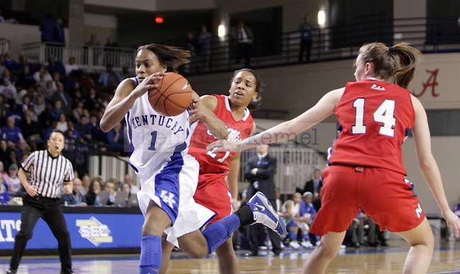 Freshman A'dia Mathies Driving to the goal in the first half of UK's game against Ole Miss on Thursday evening. Photo by William Baldon | Staff