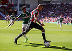 Leon Clarke of Sheffield Utd in action with Rico Henry of Brentford during the English championship league match at Bramall Lane Stadium, Sheffield. Picture date 5th August 2017. Picture credit should read: Jamie Tyerman/Sportimage
