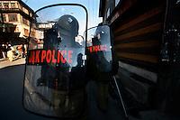 Paramilitary police retreat as they clash with stone throwing youth following Friday prayer at the Jamia Masjid mosque.  Srinagar, Kashmir, India. © Fredrik Naumann/Felix Features