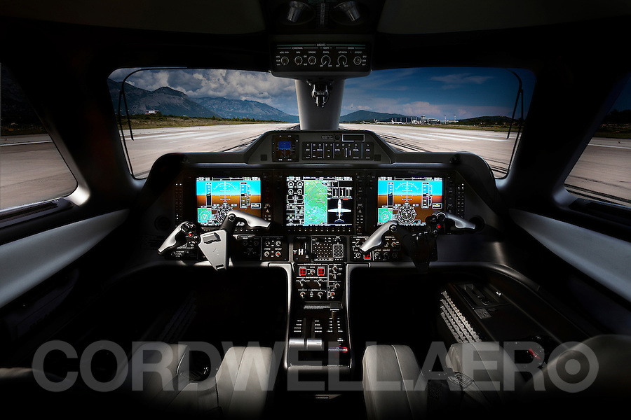 Embraer Phenom 100 Business Jet Cockpit.<br /> This image is downloadable in high, medium and low resolutions. The rights and usages are available for almost every application. Please click on the 'add to Cart' to view sizes, usages and prices. Or, if e&quot;commerce bugs you as it does me, call or email me and I will be delighted to help and advise....