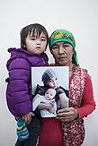 Gulden Saydigulan shows a photo of her daughter-in-law Munira Serikjan, who lives in China. She disappeared with her daughter in October 2017 in the border region Xinjiang, when she was on her way to visit her relatives in Kazakhstan.<br /> <br /> Gulden Saydigulan zeigt ein Foto von ihrer Schwiegertochter Munira Serikjan, die in China lebt. Sie verschwand mit ihrer Tochter im Oktober 2017 in der Grenzregion Xinjiang, als sie ihre Verwandten in Kasachstan besuchen wollte.