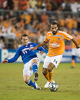Kansas City Wizards midfiedler Kurt Morsink (11) slide tackles Houston Dynamo midfielder Dwayne De Rosario (14). The Houston Dynamo defeated the Kansas City Wizards 2-0 at Robertson Stadium in Houston, TX on November 10, 2007 to capture the MLS Western Conference Championship. The Houston Dynamo will take on the New England Revolution in the MLS Cup Final on November 18, 2007 at RFK Stadium in Washington D.C.