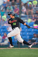 Carlos Perez (20) of the Great Falls Voyagers follows through on his swing against the Helena Brewers at Centene Stadium on August 18, 2017 in Helena, Montana.  The Voyagers defeated the Brewers 10-7.  (Brian Westerholt/Four Seam Images)