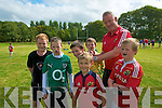 Listowel Rugby Coaching: Mick Galway, Ireland & Munster rugby star signing the jersey of James McParland  being watched by from left : Conor Beasley, Brogan McDonnell, Iarla o'Mahony , .............