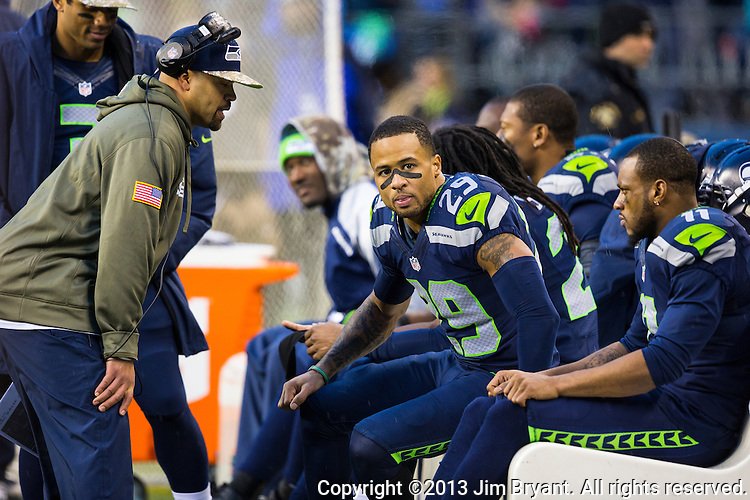 Seattle Seahawks free safety Earl Thomas (29) and Wide receiver Percy Harvin (11) listens to an assistant coach during their game against the Minnesota Vikings at CenturyLink Field in Seattle, Washington on  November 17, 2013.  The Seahawks beat the Vikings 41-20.  ©2013.  Jim Bryant. All Rights Reserved.