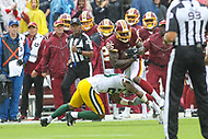 Landover, MD - September 23, 2018: Washington Redskins tight end Vernon Davis (85) is tackled during the  game between Green Bay Packers and Washington Redskins at FedEx Field in Landover, MD.   (Photo by Elliott Brown/Media Images International)