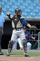 Cathcer Edwin Gonzalez (17) of International Baseball Academy in Fajardo, Puerto Rico playing for the Atlanta Braves scout team during the East Coast Pro Showcase on July 31, 2013 at NBT Bank Stadium in Syracuse, New York.  (Mike Janes/Four Seam Images)