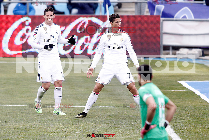 Real Madrid's James Rodriguez (l) and Cristiano Ronaldo (c) celebrate goal in presence of Getafe's Jordi Codina dejected during La Liga match.January 18,2013. (ALTERPHOTOS/Acero) /NortePhoto<br />
