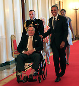 Former United States President George H.W. Bush and U.S. President Barack Obama at a ceremony in the East Room of the White House to present the 5,000th &quot;Daily Point of Life&quot; on July 15, 2013. <br /> Credit: Dennis Brack / Pool via CNP