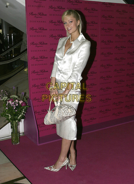 PARIS HILTON.Attends her Fragrance Launch and Signing at Debenhams, Oxford Street, London, .May 16th 2005.full length white silk jacket belt belted skirt suit Christian Dior bowling logo bag shoes matching .Ref: AH.www.capitalpictures.com.sales@capitalpictures.com.©Adam Houghton/Capital Pictures.