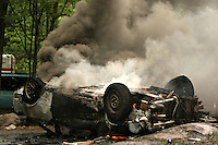 A car burns during the second day of festivity of the 2006 annual Victoria Day Weekend at Trudeau Park in Tweed, Ontario