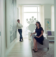 Fashion designer Jill Stuart with her husband posing for the camera in the living room of their Manhattan penthouse