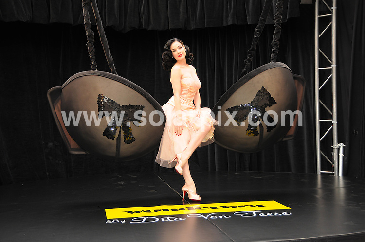 **ALL ROUND PICTURES FROM SOLARPIX.COM**.**WORLDWIDE SYNDICATION RIGHTS**.Burlesque star Dita Von Teese launched her 40s and 50s inspired lingerie collection, Wonderbra by Dita Von Teese : The Collection Unveiled, photocall at Covent Garden, London...JOB REF: 7440       MSR    DATE: 23.09.08.**MUST CREDIT SOLARPIX.COM OR DOUBLE FEE WILL BE CHARGED* *UNDER NO CIRCUMSTANCES IS THIS IMAGE TO BE REPRODUCED FOR ANY ONLINE EDITION WITHOUT PRIOR PERMISSION*