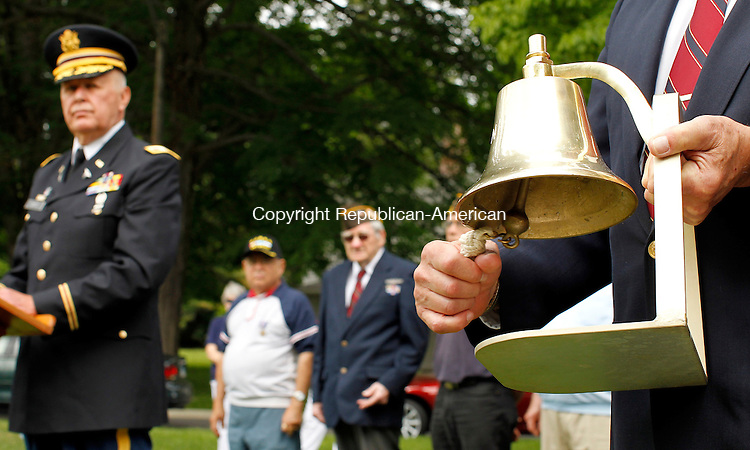 "Cheshire, CT-29, May 2010-052910CM05 Colonel Kenneth Gertz, (Ret. Army) stands in silence while John White (Ret. Navy) rings a bell honoring the fallen Korean War soldiers during a ceremony called ""Field of Flags."" The event was held honoring fallen soldiers in the Iraq and Afghanistan.  Some 5,487 flags were seen on the green in front of the First Congregational Church in Cheshire. --Christopher Massa Republican-American"