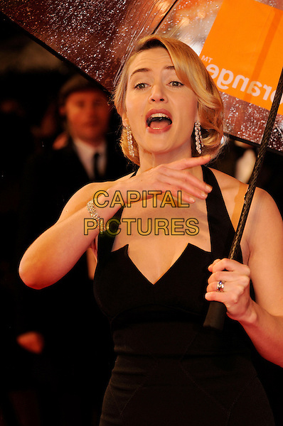 KATE WINSLET .The Orange British Academy Film Awards 2009, Royal Opera House, Covent Garden, London, England, February 8th 2009..BAFTAS arrivals half length black halterneck funny hand mouth open umbrella  pointing gesture .CAP/FIN.©Steve Finn/Capital Pictures Oscars