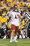 Peyton Pelluer (47), Washington State linebacker, celbrates a big play during the Cougars Pac-12 Conference road victory over the Arizona State Sun Devils, 37-32, on October 22, 2016, at Sun Devil Stadium in Tempe, Arizona.