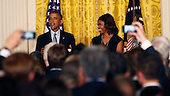 United States President Barack Obama and first lady Michelle Obama host  a reception to observe LGBT Pride Month in the East Room of the White House in Washington, D.C. on June 30, 2014.<br /> Credit: Dennis Brack / Pool via CNP