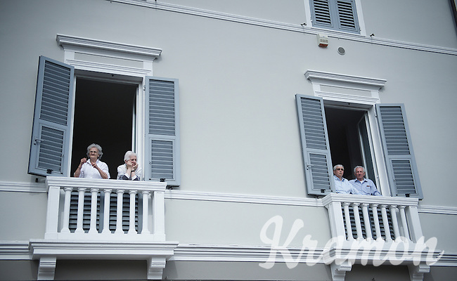 privileged spectators watching the race go by from the balcony<br /> <br /> 2015 Giro<br /> stage 3: Rapallo - Sestri Levante (136km)