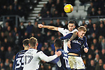 Bradley Johnson of Derby County and George Saville of Millwall compete for a header during the championship league match between Derby and Millwall at Pride Park Stadium, Derby. Picture date 23rd December 2017. Picture credit should read: Joe Perch/Sportimage