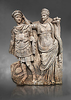 Roman Sebasteion relief  sculpture of Nero being crowned emperor by Agrippina, Aphrodisias Museum, Aphrodisias, Turkey.  Against a grey background.<br /> <br /> Agrippina crowns her young son Nero with a laurel wreath. She carries a cornucopia, a symbol of Fortune and Plenty, and he wears the armour and cloak of a Roman commander, with a helmet on the ground near his feet. The scene refers to Nero&rsquo;s accession as emperor in AD 54, and belongs before AD 59 when Nero had Agrippina murdered.