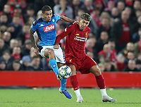 27th November 2019; Anfield, Liverpool, Merseyside, England; UEFA Champions League Football, Liverpool versus SSC Napoli ; Allan of SSC Napoli fends off Roberto Firmino of Liverpool as they compete for the ball  - Editorial Use