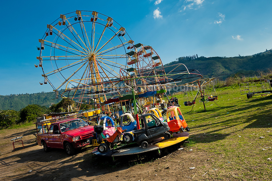 Vintage car carousel and a ferris wheel seen at a village fair in the countryside close to San Salvador, El Salvador, 7 May 2011.