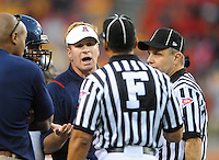 Nov. 28, 2009; Tempe, AZ, USA; Arizona Wildcats head coach Mike Stoops argues with referees against the Arizona State Sun Devils at Sun Devil Stadium. Arizona defeated Arizona State 20-17. Mandatory Credit: Mark J. Rebilas-
