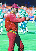 Washington Redskins receivers coach Charley Taylor looks on as his team warms-up prior to their game against the New York Jets at RFK Stadium in Washington, DC on October 25, 1987.  The Redskins won the game 17 - 16.<br /> Credit: Ron Sachs / CNP