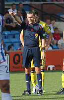 Referee Alan Muir  gets the players back 10 yards in the Kilmarnock v St Mirren Scottish Professional Football League Premiership match played at Rugby Park, Kilmarnock on 13.9.14.
