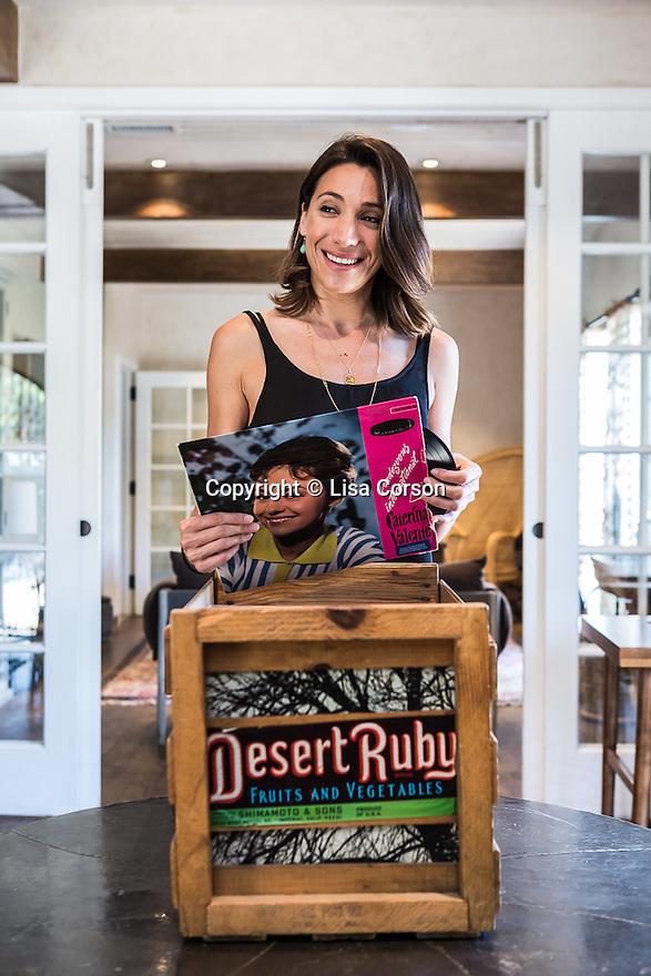 Lea Sindija, Director of Programming<br /> and Vinyl Concierge at The Goodland, looks through a crate of LPs. Goleta, California.