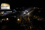Palestinian Muslim worshipers pray on June 11, 2018 outside the Dome of the Rock in the Al-Aqsa mosques compound in Jerusalem's Old City on the occasion of Laylat al-Qadr, which falls on the 27th day of the fasting month of Ramadan. Laylat al-Qadr, or Night of Destiny, marks the night Muslims believe the first verses of the Koran were revealed to the Prophet Mohammed through the archangel Gabriel. Photo by Muammar Awad